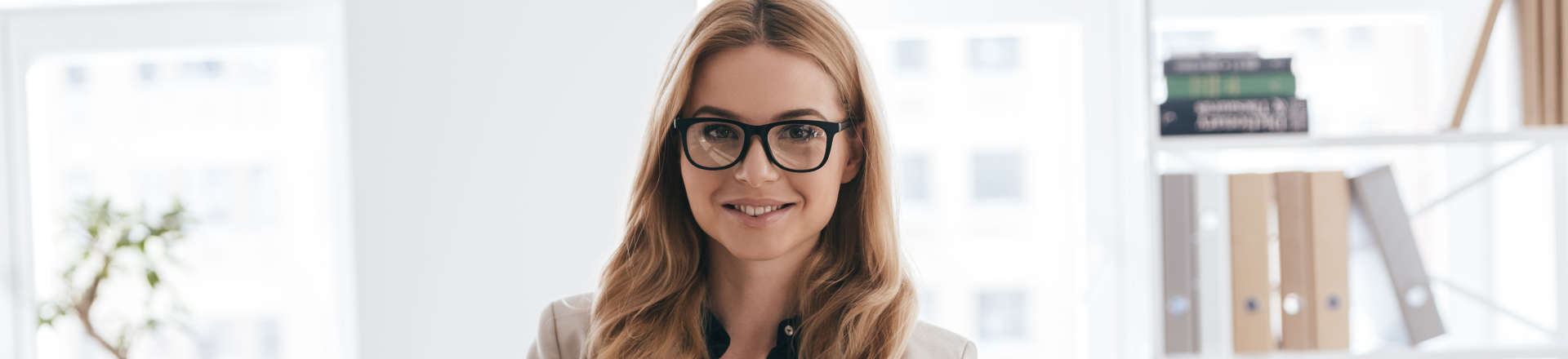 young woman wearing glasses at work in the office