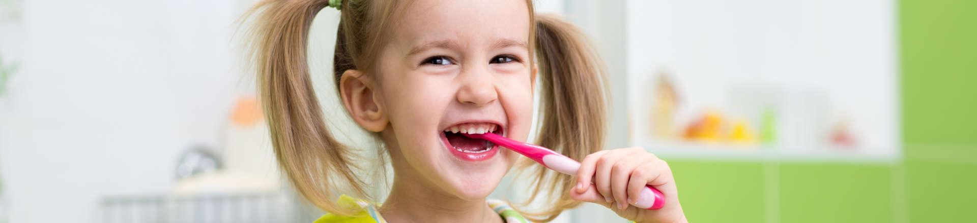 little girl brushing her teeth